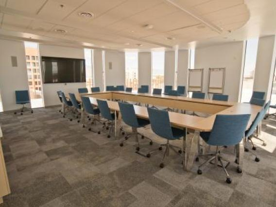 Roof conference room with large tables and chairs