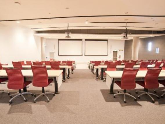 Lecture hall view of chairs behind